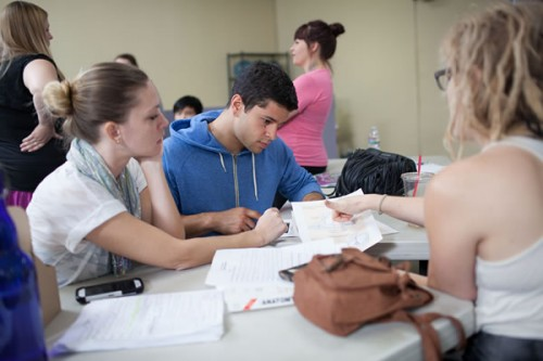 Students at a table studying.